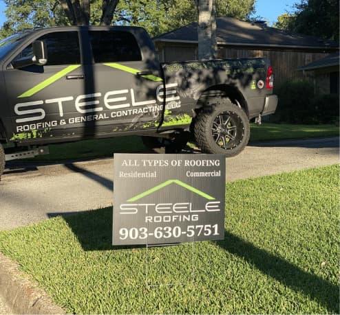 Steele roofing truck