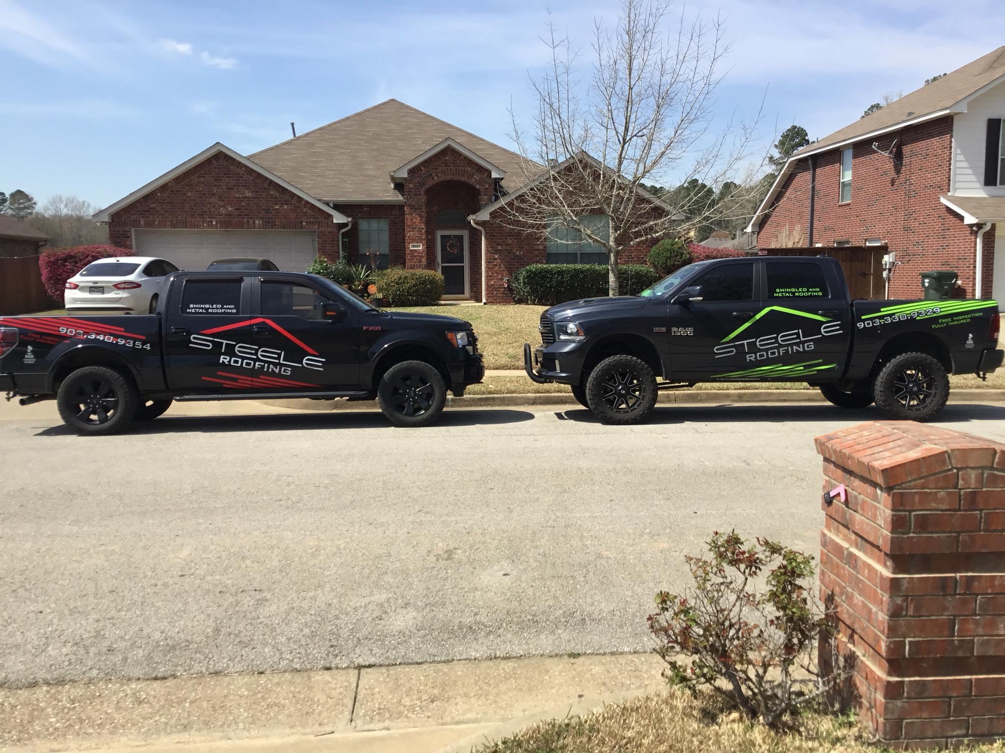 Two steeleroofing trucks